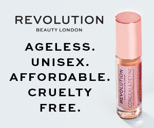 "Revolution Beauty banner to advertise the brand, there is a conceal & define concealer standing upright next to the words ""ageless. unisex. affordable. cruelty free."""
